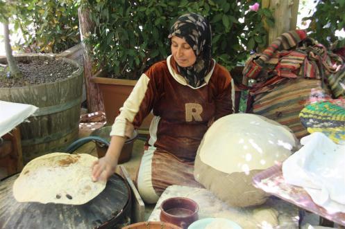 Woman making some Lebanese bread