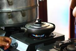 Cooking Vietnamese crepes in a pan