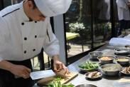 chef chopping pak choi