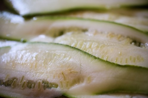 slices of zucchini cut using a mandoline