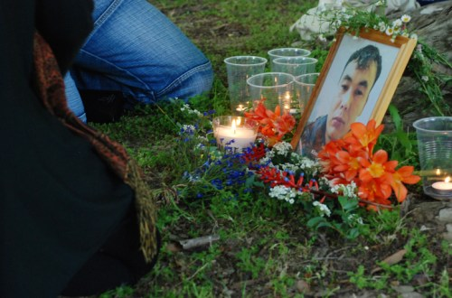 A picture of Khodayar Amini at the vigil for the one year anniversary of his death