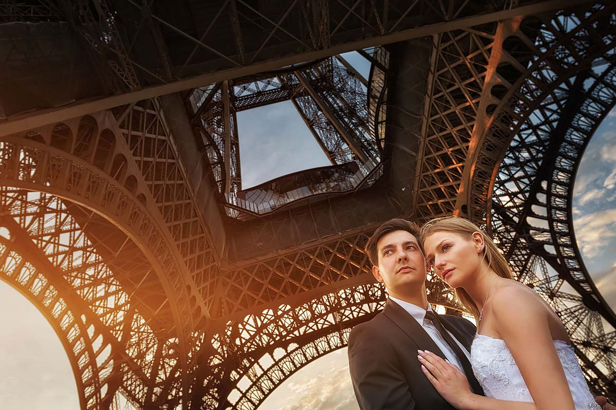 close up, wedding couple under Eiffel Tower, Paris pre-wedding
