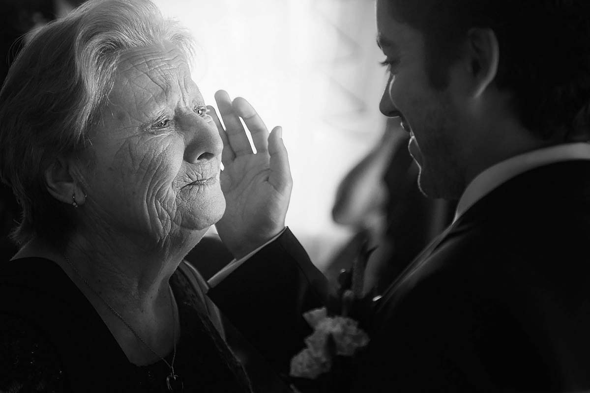 groom wipes grandma's tears