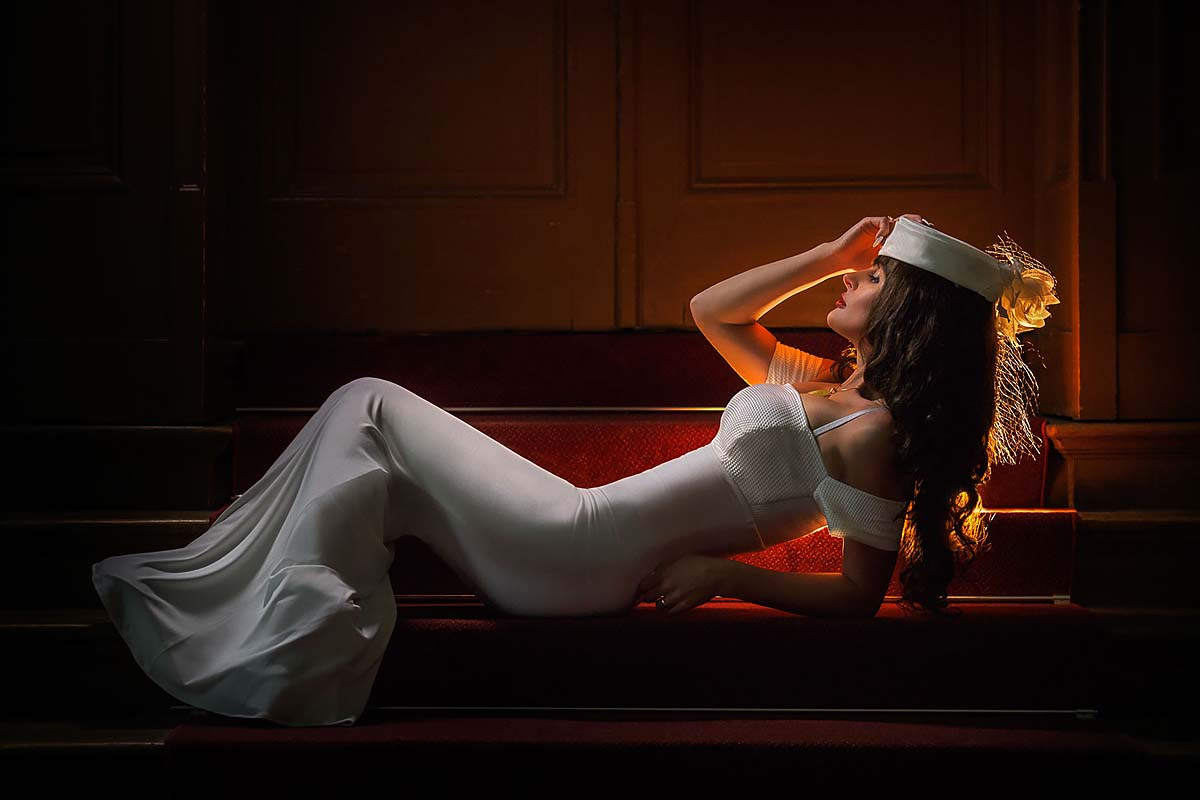 bride, laying on the stairs, backlighting
