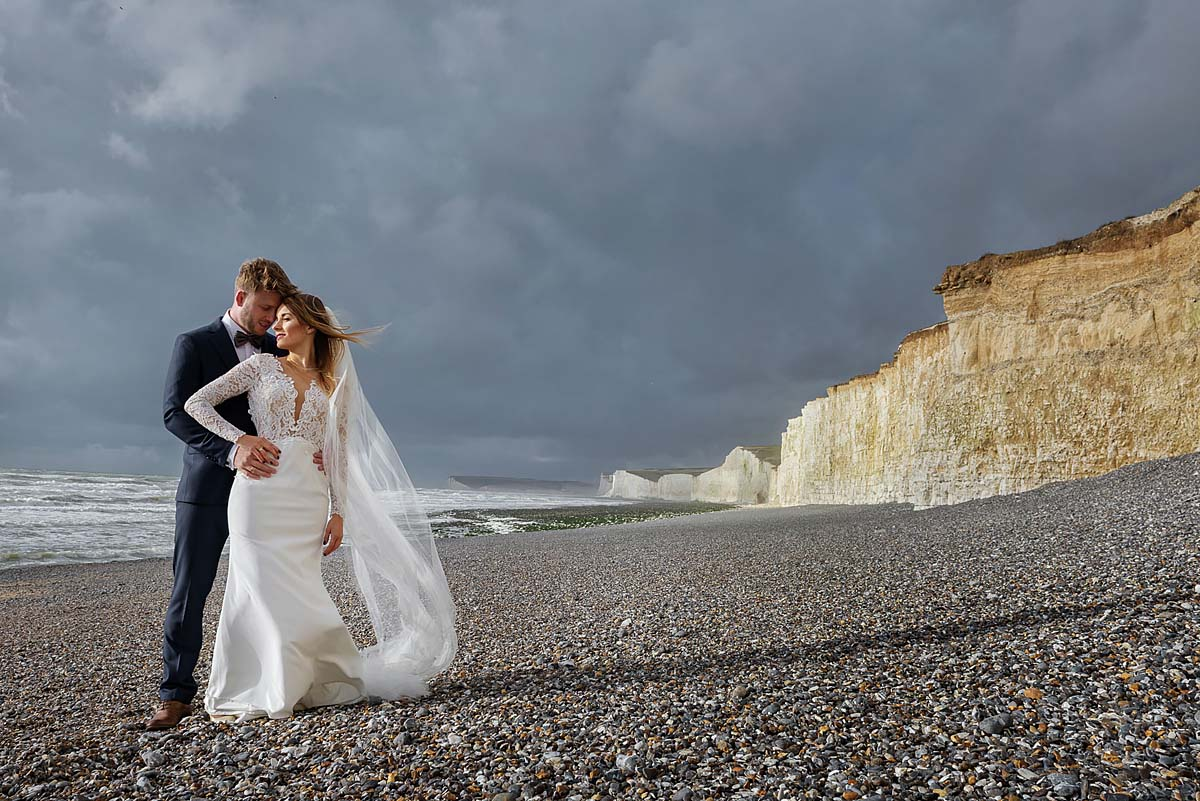 wedding couple on the beach, Seven Sisters Cliffs pre-wedding photoshoot