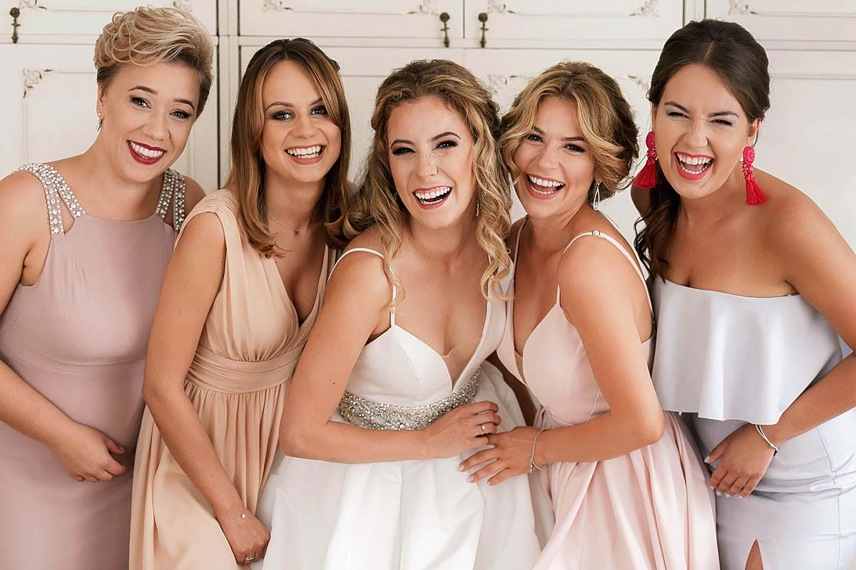 Girls, girls power, bride with bridesmaids giggles