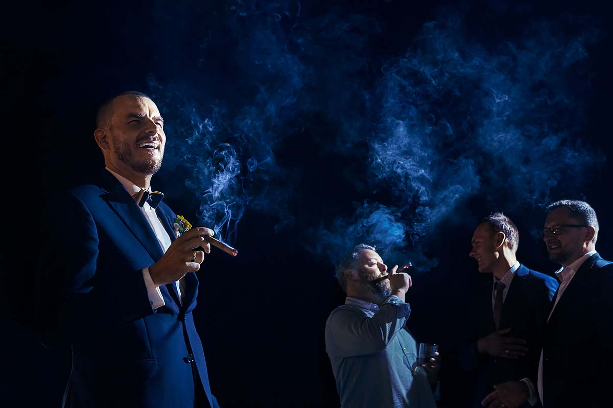 grooms with groomsmen smoking cigars
