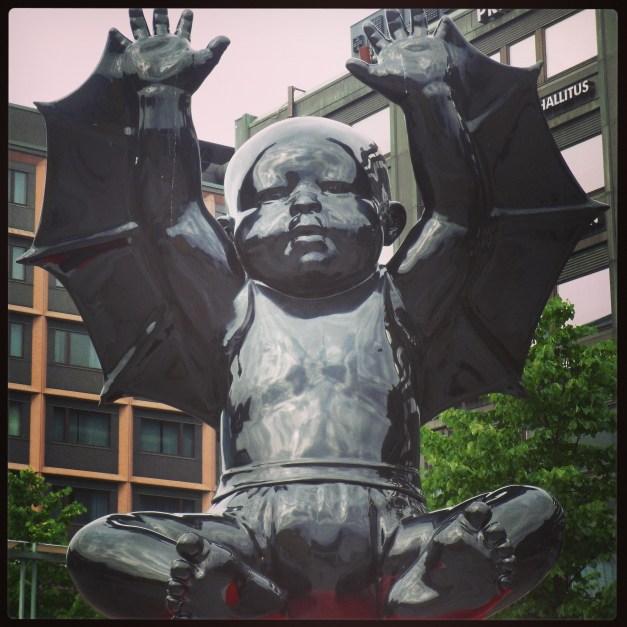 Giant evil baby sculpture, Helsinki