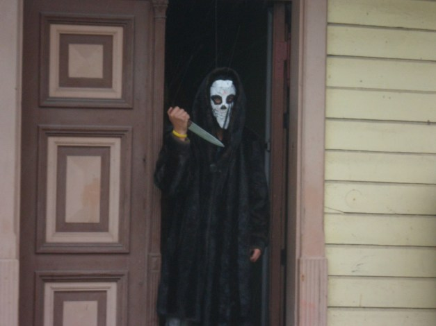 Random person lurking in the doorway of one of those melancholy houses