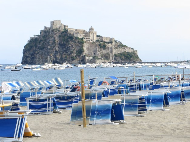 View from the beach of Ischia's stunning Castello Aragonese