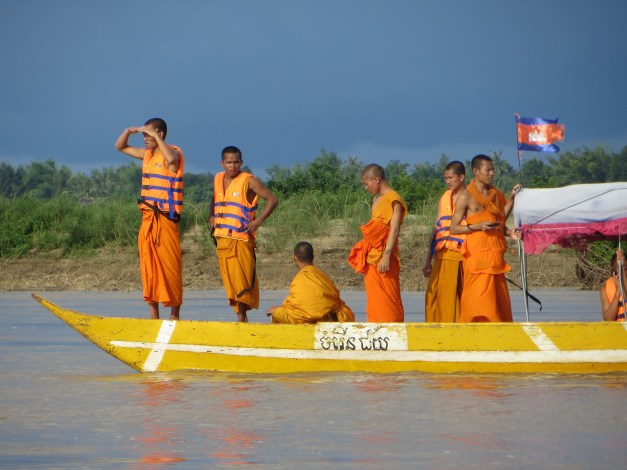 One of the highlights of Kratie is to go out on the Mekong to see the Irrawaddy dolphins, an endangered river dolphin. We saw dolphins - or more precisely, we saw some fins breaking the surface, but the highlight was this boatful of Buddhist monks with a storm brewing behind them. The storm came in hard and fast, so we just tied up to some bushes in mid-river and waited it out. Apparently rainstorms are pretty common in this part of the world.