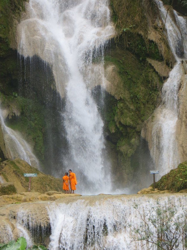 Flashback to Luang Prabang, Laos. This was the waterfall we biked to our last day in Laos, with a couple young monks enjoying the view.