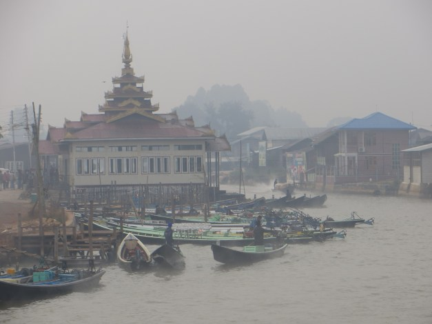 Nyaung Shwe is at about 3,000 feet altitude and we were shocked how cold it was. This is early morning on the canal that goes out to Inle Lake, all early morning mist.