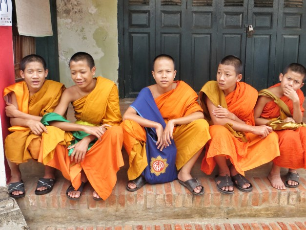 Orange-clad monks help make Luang Praban a very colorful place.
