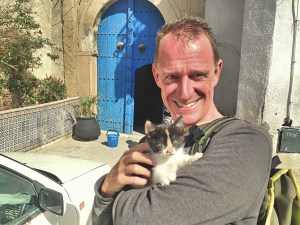 Tunis has a lot of pretty mangy looking kitties. The cute kitten was right outside our front door, the blue one in back of Mark.