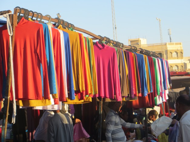 """One evening we went to the weekly market in Tozeur, the """"big city"""" in the region. Colorful, atmospheric, and aromatic, you could get pretty much anything you wanted here as long as what you wanted was cheap."""