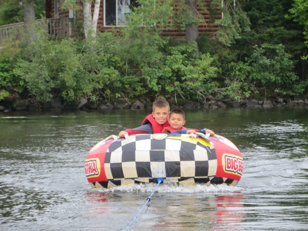 My great-nephews Matt & Dex on the tube behind a boat.