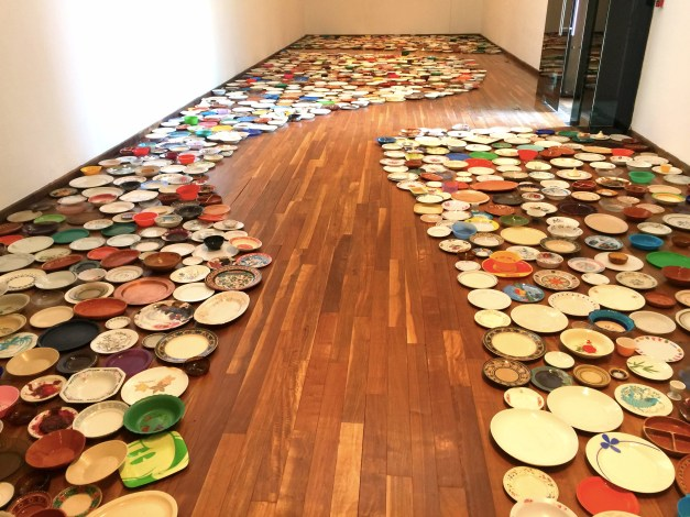 This was a display of hundreds of plates, mostly or all cheap, everyday plates. They call it art.