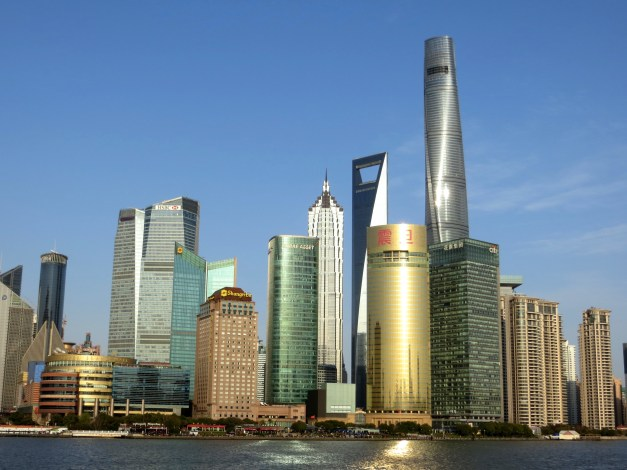 The skyline of Pudong, the financial center of Shanghai. The tallest building over on the right is the Shanghai Tower, while the World Financial Center and Jin Mao Tower are the somewhat smaller buildings to the left.