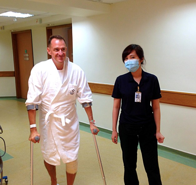 A couple hours after surgery, Mark learns how to walk with crutches