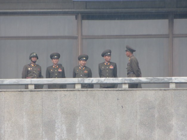 A close up of the North Korean brass watching us. You wonder what they think of the Defense Minister having recently been executed for falling asleep.