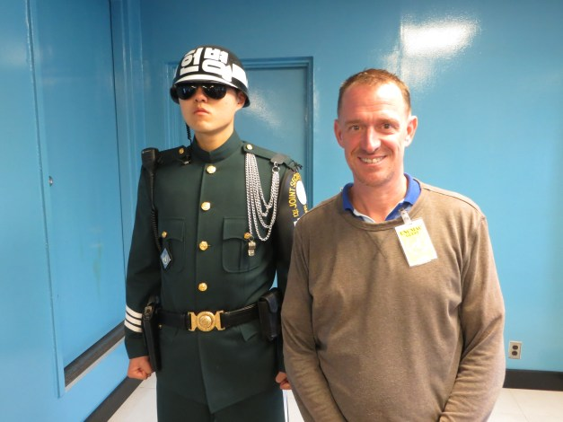 Mark posing with a South Korean soldier … in North Korea!