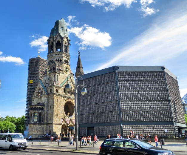 The Kaiser Wilhelm Memorial Church, consisting of the remains of the late 19th century original, severely damaged during the war, and the 1960s new construction in front