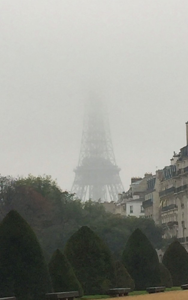 Our first view of the Eiffel Tower, the top shrouded in mist
