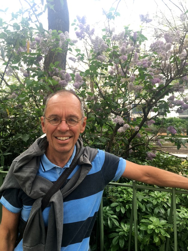 Happy Jim in front of some lilacs