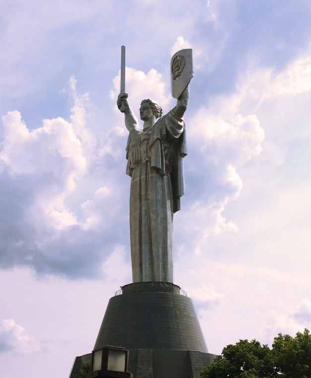 The giant Motherland Monument, standing some 335 feet tall overlooking the Dnieper River. Built in the late 1970s it still displays the old Soviet hammer and sickle. Amusingly, the sword was cut back because it reached higher than the cross of a nearby monastery.
