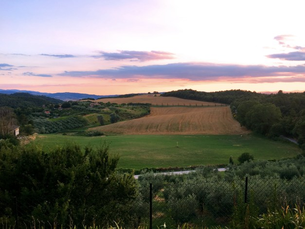 Sunset and the view of the Val d'Orcia from our bedroom. In the morning I'd go running up that dirt road in the foreground. Could it get any better?