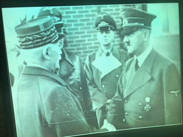 The museum in Caen did not try to whitewash France's collaboration with Hitler. This photo of Marshal Pétain, the hero of Verdun, meeting with Hitler tells it all.