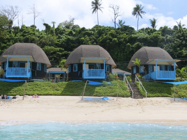 That's our fale in the middle, little baseball-cap-like huts with limited facilities. But you couldn't get closer to the beach and the porch there was a perfect spot for a night-cap.