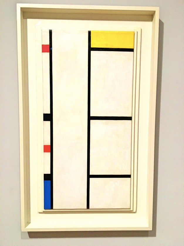 """Mondrian did this initially in 1935, when Paris was laying railroad tracks and stringing electric wires. Everything was all straight lines and all that, and in the original version there was no color, only the black lines on white. Then he moved to New York, learned to love jazz, and, in 1942 added the blue, red, and yellow boxes, """"bringing in a little boogie-woogie,"""" as he put it."""
