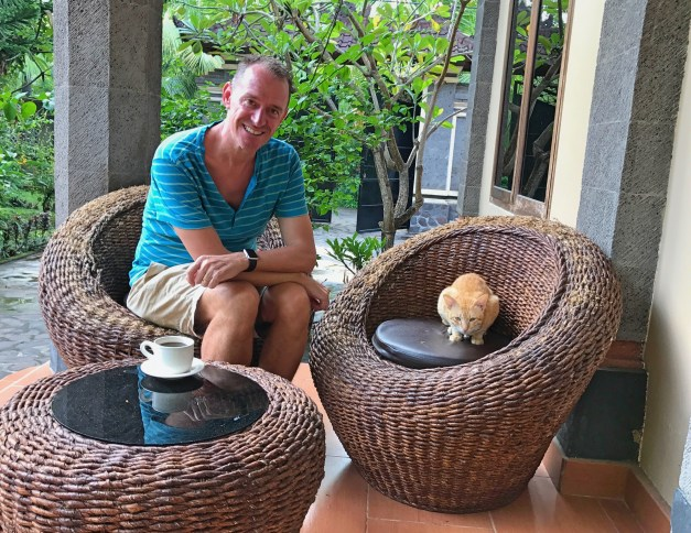 The only outdoor sitting area at our replacement villa was distinctly inferior to what we'd become used to at Villa Padma. There was, though, a cat, which helps. Note the top of the wicker chair she's sitting on: she's spent a lot of time clawing away at it!