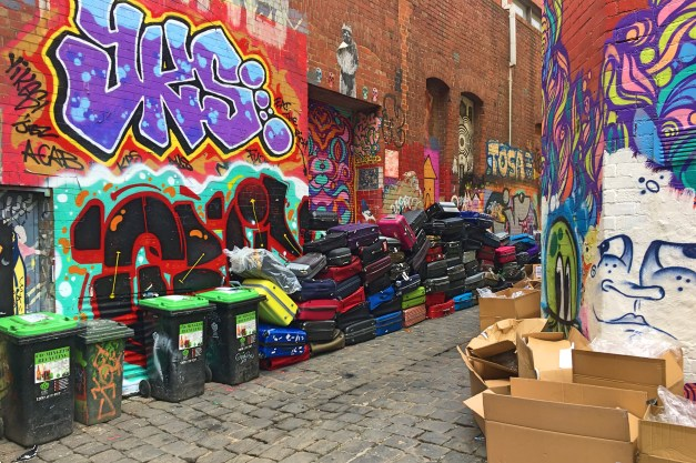 Melbourne is famous for its colorful lanes, alleys with great street art. Here the art is combined with ... suitcases.