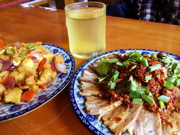 And finally, dinner - kung pao chicken on the left and a cold yak dish on the right. Even the tea was interesting, hot water poured over buckwheat. Surprisingly good!