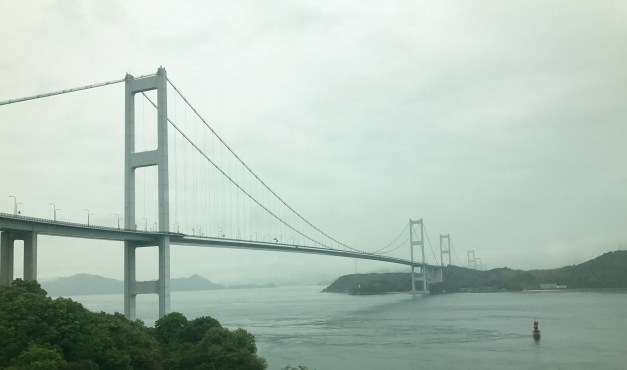 The Kurushima Kaikyo Bridge, the world's longest suspension bridge. And we bicycled over it in the rain!