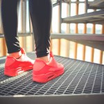 Woman with red sneakers