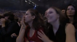 excited girl with anxious girl at Michael J. show