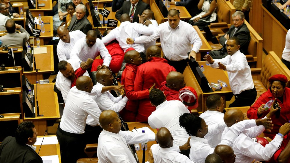 Security officials remove members of the Economic Freedom Fighters during President Jacob Zuma's State of the Nation Address (SONA) to a joint sitting of the National Assembly and the National Council of Provinces in Cape Town, South Africa February 9, 2017. REUTERS/Sumaya Hisham