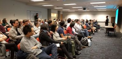 Photo of Alan Albert presenting to an audience