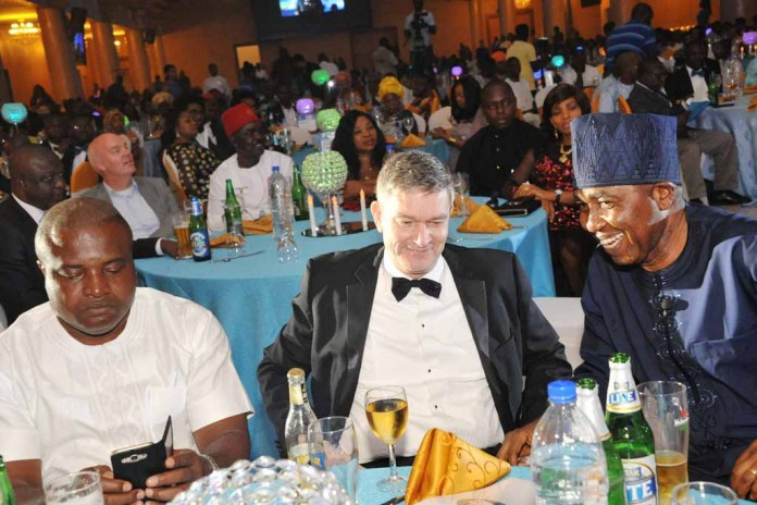 L-R: Mr. Ken Maduakor, Nigerian Breweries Plc Distributor of the Year; Mr. Nicolaas Velvede, Managing Director Nigerian Breweries; and Mr. Hubert Eze, Sales Director, Nigerian Breweries at the Distributors Award Night in Lagos on Friday.