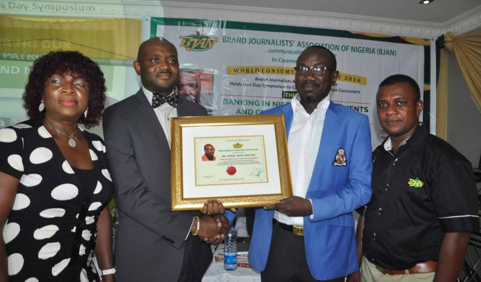 L-R: Mrs Neta Nwosu, former Chairman of BJAN, Mr. Celey Okogun, MD/CEO, Novel Potter presenting award to Mr. Isreal Jaiye Opayemi, MD/Chief Strategist, Chain Reactions Nigeria and Mr. Goddie Ofose, Chairman BJAN looks on at the 4th Brand Journalist Association of Nigeria (BJAN) Consumer Rights Day Symposium 2016, with the theme: Banking in Nigeria Developments and Customers Challenges held at White House Hotel GRA-Ikeja Lagos.