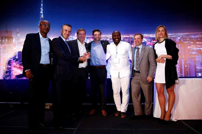 """Global Technology Partners (GTP) executives displaying the 'Visa Prepaid Service Provider of the Year' award at the Shangri-La Hotel in Dubai, United Arab Emirate, venue of the Prepaid Summit Middle East and Africa 2016."""""""