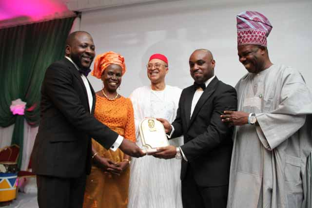 Prof. Pat Utomi (3rd Left) and Elder (Mrs) Inyang Anya (2nd Left) presenting the Zik Award for Professional Leadership to Biodun Shobanjo, represented by his sons Tunde Shobanjo (1st Left) and Olufemi Shobanjo (4th Left) while Ogun State Governor, Ibikunle Amosun felicitates with them at the 2015 Annual Zik Prize Awards at the Civic Centre, Victoria Island, recently.