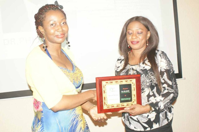 Representative of the MD of Wetherheads Advertising Group, Jennifer Onose, presenting award to the Executive Director, JSP Communications, Mrs Aderonke Adebule on behalf of Dr Phil Osagie,, recently at Nigeria Brand Awards 2016.