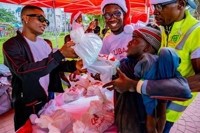 Uzoka, Wizkid Give Back To Thousands At The UBA Foundation Food Bank-marketingspace.com.ng