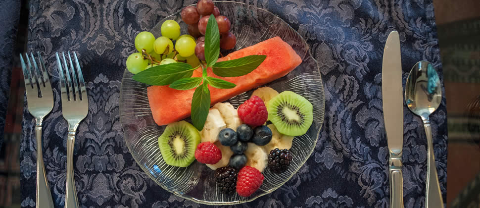 Plate full of Green kiwi, Red Watermelon, red raspberry, green grapes, banana's