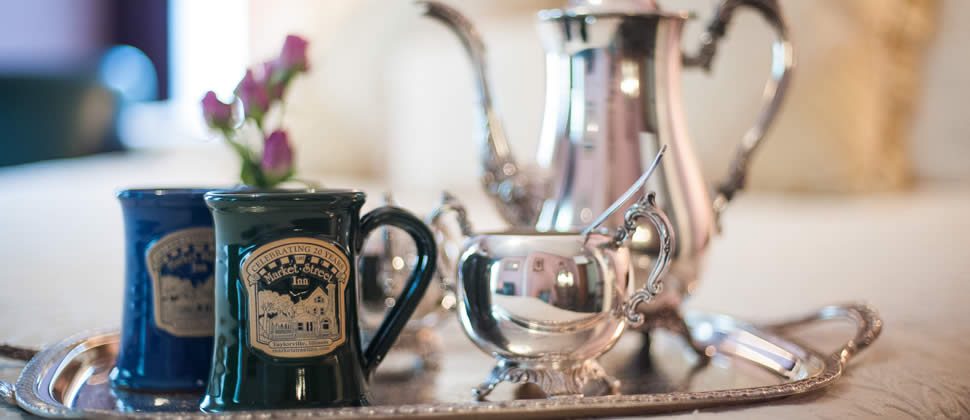 Two Market Street Inn mugs on a silver try with a Silver Coffee craft, and sugar bowl